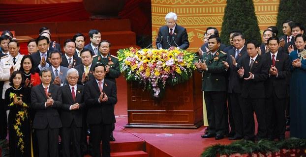 Hình minh hoạ. Tổng bí thư Nguyễn Phú Trọng (giữa) phát biểu trước 200 uỷ viên Ban chấp hành Trung ương tại phiên bế mạc đại hội 12 ở Hà Nội hôm 28/1/2016