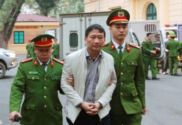 Ảnh minh họa: Trịnh Xuân Thanh bị dẫn giải đến tòa ở Hà Nội vào ngày 22/1/2018